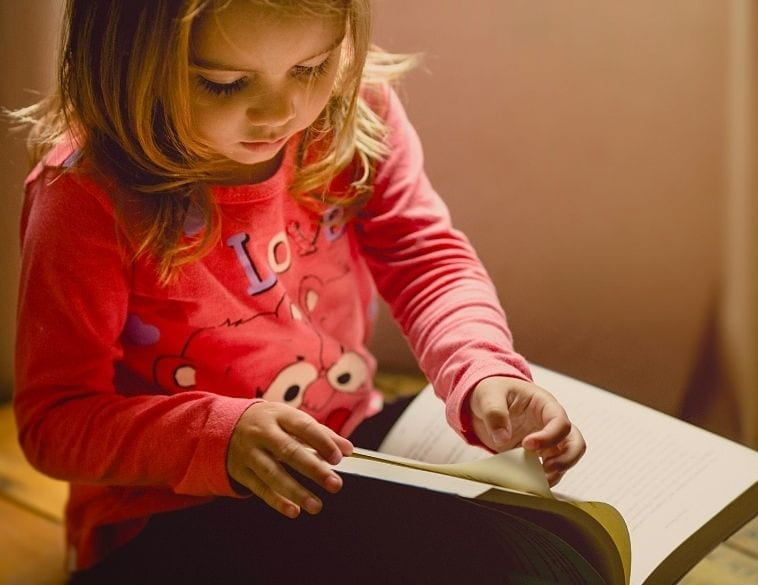 Child reading from a book
